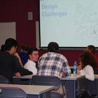 A group of iCons students brainstorm at Fall Workshop